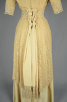 Dress, cream silk faille with ecru embroidered net, c.1910, detail of pendant fabric in back by Irma G. Bowen Historic Clothing Collection