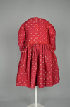 Boy's dress, wool challis printed red, with white polka dots, c. 1897, back view by Irma G. Bowen Historic Clothing Collection