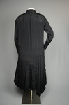 Dress, black silk with dropped waist and scalloped pleated panels, 1920s, back view by Irma G. Bowen Historic Clothing Collection
