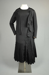 Dress, black silk with dropped waist and scalloped pleated panels, 1920s, front view by Irma G. Bowen Historic Clothing Collection