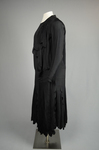 Dress, black silk with dropped waist and scalloped pleated panels, 1920s, side view by Irma G. Bowen Historic Clothing Collection