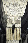 Dress, cream satin with black chiffon overlay and tasseled, embroidered panels, c. 1910s (refurbished), detail of bodice panel by Irma G. Bowen Historic Clothing Collection