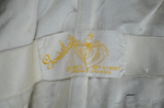 Dress, cream satin with black chiffon overlay and tasseled, embroidered panels, c. 1910s (refurbished), detail of label by Irma G. Bowen Historic Clothing Collection