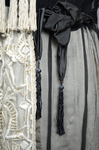 Dress, cream satin with black chiffon overlay and tasseled, embroidered panels, c. 1910s (refurbished), detail of sash by Irma G. Bowen Historic Clothing Collection