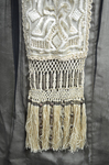 Dress, cream satin with black chiffon overlay and tasseled, embroidered panels, c. 1910s (refurbished), detail of skirt panel by Irma G. Bowen Historic Clothing Collection