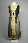 Dress, cream satin with black chiffon overlay and tasseled, embroidered panels, c. 1910s (refurbished), front view by Irma G. Bowen Historic Clothing Collection