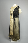 Dress, cream satin with black chiffon overlay and tasseled, embroidered panels, c. 1910s (refurbished), quarter view by Irma G. Bowen Historic Clothing Collection