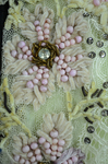 Bodice, black lace over green faille and pale green organdy with shoulder frills, pink beaded flowers, and sequins, c. 1898, detail of embroidery by Irma G. Bowen Historic Clothing Collection