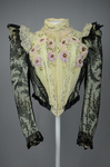 Bodice, black lace over green faille and pale green organdy with shoulder frills, pink beaded flowers, and sequins, c. 1898, front view by Irma G. Bowen Historic Clothing Collection