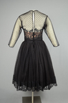 Cocktail dress, black point d'esprit with lace over black rayon lining, 1950s, back view by Irma G. Bowen Historic Clothing Collection