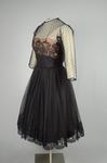 Cocktail dress, black point d'esprit with lace over black rayon lining, 1950s, side view by Irma G. Bowen Historic Clothing Collection