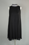 Cocktail dress, sleeveless A-line with black crepe and black chiffon overlay, with a rhinestone collar, 1960s, front view by Irma G. Bowen Historic Clothing Collection