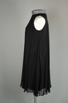 Cocktail dress, sleeveless A-line with black crepe and black chiffon overlay, with a rhinestone collar, 1960s, side view by Irma G. Bowen Historic Clothing Collection