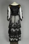 Dress, black silk satin and point d'esprit bobbinet with organdy and cord appliqué, c. 1915-1918, back view by Irma G. Bowen Historic Clothing Collection