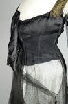 Dress, black silk satin and point d'esprit bobbinet with organdy and cord appliqué, c. 1915-1918, detail of center opening in lining, with high plain bobbinet and point d'esprit attachments by Irma G. Bowen Historic Clothing Collection