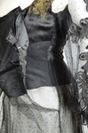 Dress, black silk satin and point d'esprit bobbinet with organdy and cord appliqué, c. 1915-1918, detail of side opening in outer layers, with high plain bobbinet and point d'esprit attachments by Irma G. Bowen Historic Clothing Collection