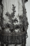 Dress, black silk satin and point d'esprit bobbinet with organdy and cord appliqué, c. 1915-1918, detail of skirt by Irma G. Bowen Historic Clothing Collection