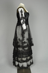 Dress, black silk satin and point d'esprit bobbinet with organdy and cord appliqué, c. 1915-1918, side view by Irma G. Bowen Historic Clothing Collection
