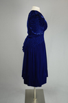 Dress, blue velvet with smocked waist and shoulders, 1938, side view by Irma G. Bowen Historic Clothing Collection