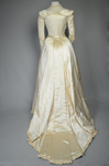 Wedding dress, cream silk satin and lace with long sleeves and a train, c. 1905, back view by Irma G. Bowen Historic Clothing Collection