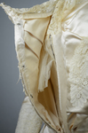 Wedding dress, cream silk satin and lace with long sleeves and a train, c. 1905, detail of padding between satin and lining by Irma G. Bowen Historic Clothing Collection