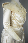 Wedding dress, cream silk satin and lace with long sleeves and a train, c. 1905, detail of sleeves by Irma G. Bowen Historic Clothing Collection