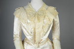Wedding dress, cream silk satin and lace with long sleeves and a train, c. 1905, detail of bodice front by Irma G. Bowen Historic Clothing Collection