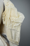 Wedding dress, cream silk satin and lace with long sleeves and a train, c. 1905, detail of padding inside lining by Irma G. Bowen Historic Clothing Collection