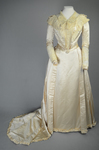 Wedding dress, cream silk satin and lace with long sleeves and a train, c. 1905, front view by Irma G. Bowen Historic Clothing Collection