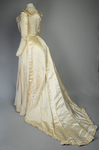 Wedding dress, cream silk satin and lace with long sleeves and a train, c. 1905, quarter view by Irma G. Bowen Historic Clothing Collection