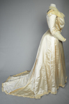 Wedding dress, cream silk satin and lace with long sleeves and a train, c. 1905, side view by Irma G. Bowen Historic Clothing Collection