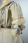 Wedding dress, pale green silk crepe with silver satin pont d'esprit,and lace, with matching gray shoes with steel-cut beads, 1907, detail of sleeve by Irma G. Bowen Historic Clothing Collection