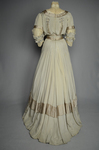 Wedding dress, pale green silk crepe with silver satin, pont d'esprit, and lace, with matching gray shoes with steel-cut beads, 1907, back view by Irma G. Bowen Historic Clothing Collection