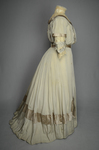 Wedding dress, pale green silk crepe with silver satin, pont d'esprit, and lace, with matching gray shoes with steel-cut beads, 1907, side view by Irma G. Bowen Historic Clothing Collection