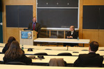 Symposium speakers UNH Professor of History David Bachrach (standing) and UNH Professor of Law Marcus Hurn