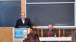 Symposium speakers UNH Professor of Law Marcus Hurn (standing) and UNH Professor of History David Bachrach
